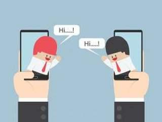 两个商人在有讲话泡影的智能手机沟通
