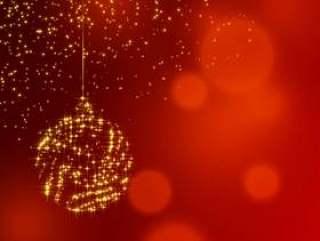 圣诞闪亮的装饰球红色闪光背景上