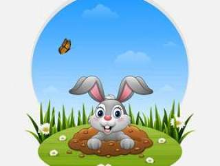卡通兔子走出草地上的洞