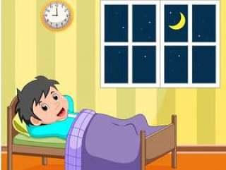 微笑的小男孩在床上睡觉