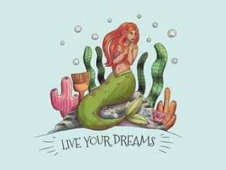 坐在与海草和珊瑚的石头的逗人喜爱的美人鱼