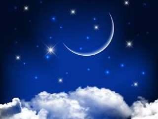 与云彩之上的月亮的夜空背景