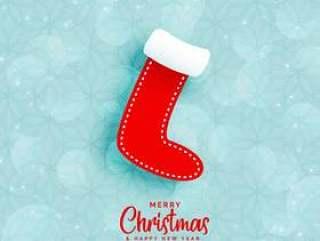 与圣诞节冬天袜子的蓝色背景