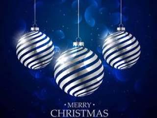 与银色圣诞节球和bokeh作用的深蓝背景