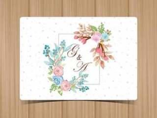 与美丽的蓝色和桃红色玫瑰的花卉婚礼徽章