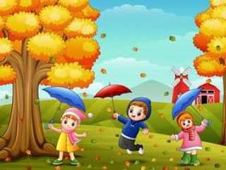 使用与在农厂风景的伞的愉快的孩子