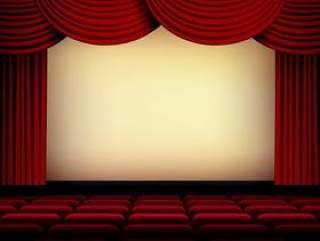 剧院或电影院礼堂屏幕与红色帷幕和位子