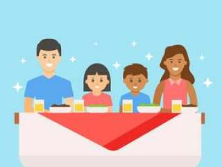 吃晚餐的愉快的多民族家庭