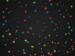 在黑暗的背景中多彩闪光