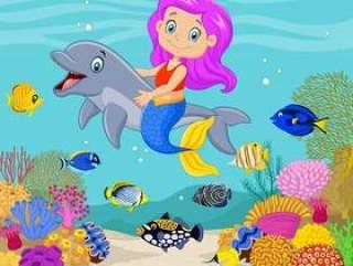 与海豚的逗人喜爱的美人鱼在水下的背景中